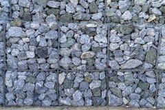 Gabion fences, Stone wall. Texture of gabion fences, wire mesh fence stock image