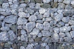 Gabion fences, Stone wall. Texture of gabion fences, wire mesh fence royalty free stock image