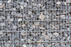 Gabion, metal basket filled with thick stones. Royalty Free Stock Images