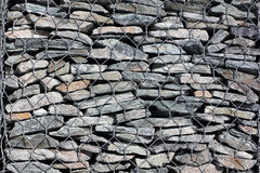 Gabion-protection against taluses, background. Gabion wall - protection of the mountain road from rocky talus Stock Photos