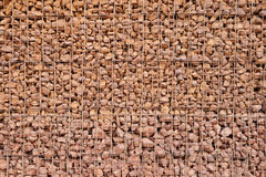 Gabion retaining wall. Wire mesh gabion and loose rock retaining wall background royalty free stock photography
