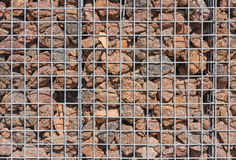Gabion wall filled with lava stones Stock Photos