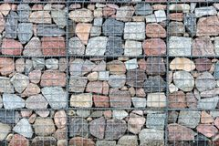 Gabion Wall Made Of Natural Stone And Metal Mesh. Stock Photography