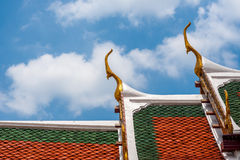 Gable apex on blue sky with cloud. Wat Phra Kaew, Bangkok, Thailand Stock Photos