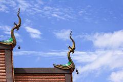 Gable apex of church. And some clouds background in a temple Thailand Stock Photos