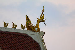 Gable apex. A gable is decorated with a gable apex, a leaf-shaped gable-edging in the shapes of Phya Naga, dragon and mythical creatures, which are entirely made Stock Images