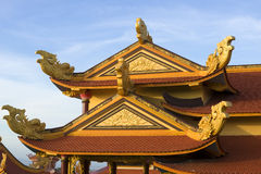 The gable of a Buddhist temple with the sea dragons. The surroundings of Phan Thiet Royalty Free Stock Photos
