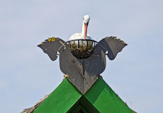 Gable decor of horse heads and a stork Stock Photos