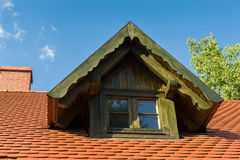 Gable dormer. On a red tiled roof Royalty Free Stock Image