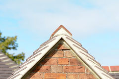 Gable end of house with lines of tiles Royalty Free Stock Photography