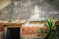 Gable end of an old buddhist church with old door and grungy bri Royalty Free Stock Photo