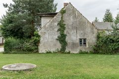 Old, uninhabited house. Gable of an old, gray uninhabited house in the countryside Stock Photography