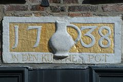 Gable ornament with text. `In the Cologne mug` in the facade of an historic building in Maasstricht, The Netherlands stock photography