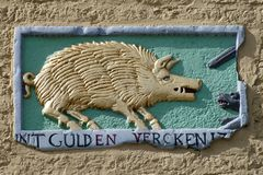 Gable ornament with text. `In the golden pig` in the facade of an historic building in Maasstricht, The Netherlands royalty free stock photography