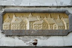 Gable ornament with text. `In the town of Antwerp  ` in the facade of an historic building in Maasstricht, The Netherlands stock photography