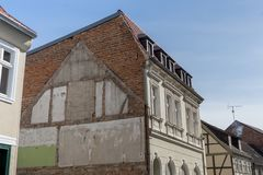 House facade in a small town. Gable of a residential building in Germany with remains of room walls Royalty Free Stock Photos