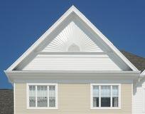 Gable roof on a house. Against deep blue sky Stock Photos