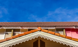 Gable roof of a house. In front of the blue sky Stock Image