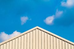 Gable roof metal steel construction house country style  concept idea against clear sky background missing home royalty free stock photography