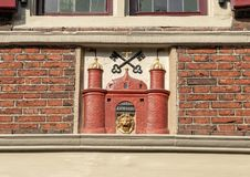 Gable Stone, The Riga Coat of Arms house in Amsterdam, located at Oudezijds Voorburgwal 14. Pictured is the gable stone with the crossed keys of heaven on The stock images