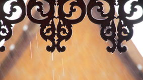 Gable of thai style house with water drops from very heavy rain outside stock footage