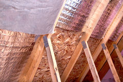 Gable View of Ongoing House Attic insulation Project with Heat a Stock Photo