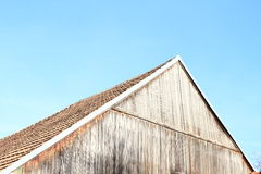 Gable. Wooden gable on roof of an old house under blue sky stock photography