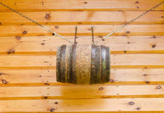 Gable of wooden rural house and barrel with chains Royalty Free Stock Photos