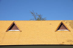 Gable on the yellow roof Royalty Free Stock Images