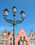 Gabled houses of brugge. Ornate lanterns tower over traditional gabled houses in Brugge, Belgium Royalty Free Stock Photo
