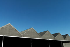 Gabled roof modern tin with blue sky Royalty Free Stock Photo