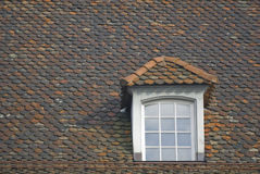 Gabled window on tiled roof Stock Photo