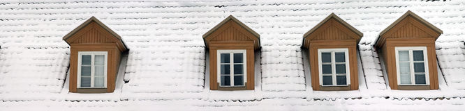 Gables Panorama. Four gables and a snow-covered roof, Vilnius, Lithuania stock photos