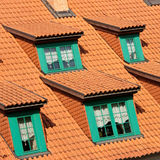Gables on red roof. Details of green windows or gables on a red tiled roof royalty free stock photography