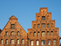 Gables of the salt storages of Luebeck, Germany. Salt storages of Luebeck and its mirroring in the river Stock Photography