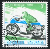 Motorsport. GABON - CIRCA 1976: stamp printed by Gabon, shows motorsport, circa 1976 stock photo