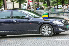 Gabon Diplomatic car during Military parade (Defile) in Republic Day (Bastille Day). Champs Elysees Stock Photo