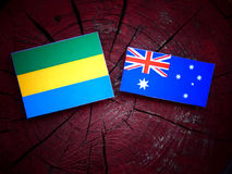 Gabon. Flag with Australian flag on a tree stump Stock Photos