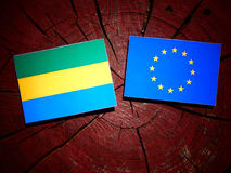 Gabon flag with EU flag on a tree stump isolated. Gabon flag with EU flag on a tree stump Stock Photography