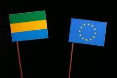 Gabon flag with European Union EU flag isolated on black. Background Stock Photo
