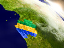 Gabon with flag in rising sun Stock Photography