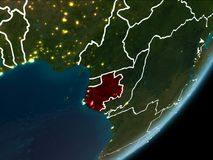 Gabon on night Earth. Gabon as seen from Earth's orbit on planet Earth at night highlighted in red with visible borders and city lights. 3D illustration Royalty Free Stock Photos