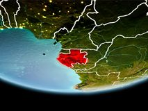 Gabon in red in the evening. Country of Gabon in red on planet Earth in the evening with visible border lines and city lights. 3D illustration. Elements of this Stock Image