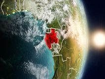 Gabon during sunrise. Highlighted in red on planet Earth with visible country borders. 3D illustration. Elements of this image furnished by NASA Stock Image