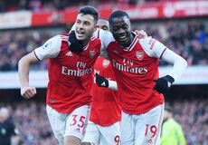 Free Gabriel Martinelli Of Arsenal FC Celebrates A Goal With Nicolas Pepe Stock Photography - 188084202