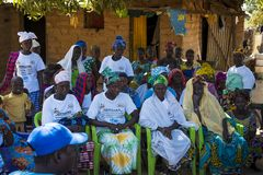 Group of women and chldren at a community meeting in the village of Mandina Mandinga in the Gabu Region. Gabu Region, Republic of Guinea-Bissau - February 7 stock photo