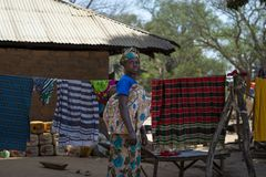 Portrait of a woman carrying her baby on shoulders, in the village of Mandina Mandinga in the Gabu Region. Gabu Region, Republic of Guinea-Bissau - February 7 royalty free stock images