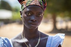 Portrait of a woman in the village of Mandina Mandinga in the Gabu Region, Guinea Bissau. Gabu Region, Republic of Guinea-Bissau - February 7, 2018: Portrait of royalty free stock image