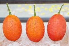 Gac Fruit on ice basket Stock Photo