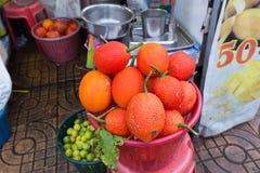 Gac fruit in market Stock Images